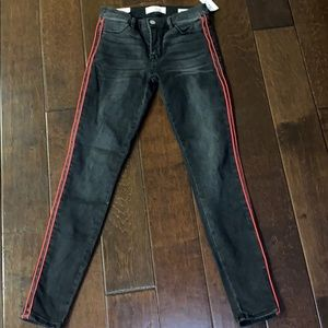 black pacsun skinny jeans with red stripes